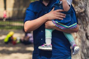 father-carrying-daughter_925x