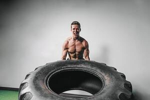 man-lifts-tire-exercise