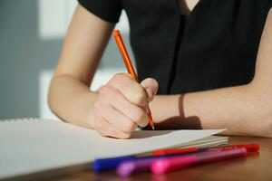 student-writing-on-paper